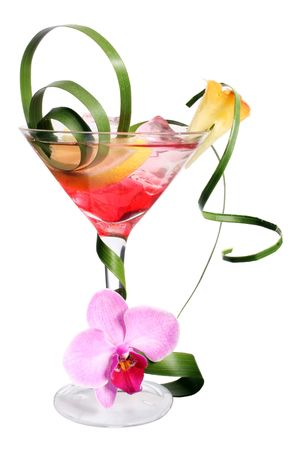 Extravagant tropical cocktail with fruit and palm leaf garnish Stock Photo