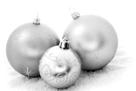 Three Christmas baubles in black and white