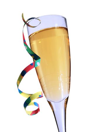 cava: Champagne glass with blue hue and party streamer with white background