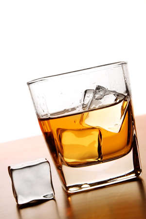 Glass of Whiskey with ice cube Stock Photo