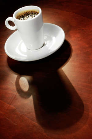 expresso: Expresso on warm surface with long shadow