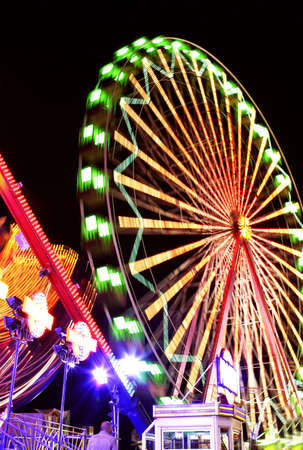 fairground: Fairground at night with bright lights and motion blur
