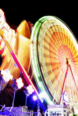 Night time motion blur with spinning ferris wheel Stock Photo