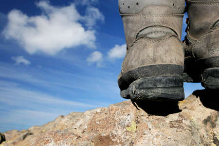 walking boots: Walking boots with blue sky in the background Stock Photo