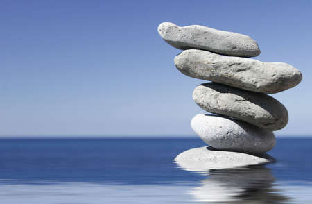 Stack of pebbles in shallow water with blue sky background Stock Photo - 779157