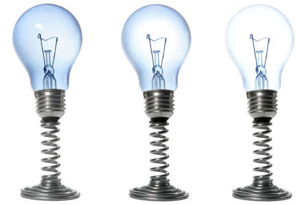 Three lightbulbs on stands with varying brightnesses Stock Photo - 799064