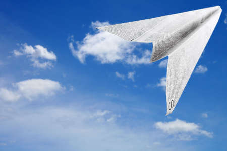 Paper aeroplane made of newspaper page in flight Stock Photo - 792333