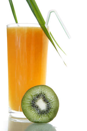Orange juice with kiwi garnish and palm leaf Stock Photo - 792328