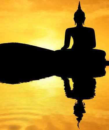 Thai style buddha at sunset photo