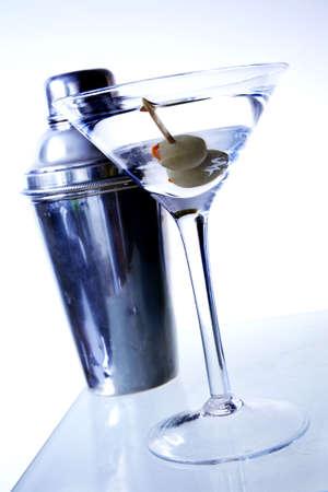 martini shaker: Two olive martini on underlit bar with shaker Stock Photo