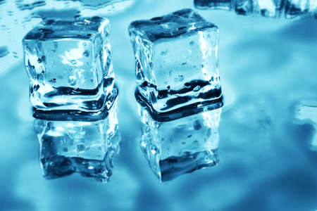 blue toned: Blue toned ice cubes on reflective surface