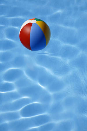 beachball: Colorful beachball floating in bright blue pool