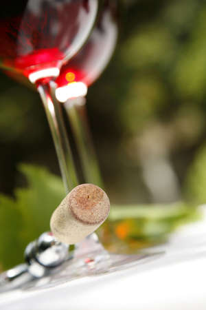 Red wine in glasses with cork on corkscrew photo