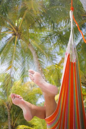 sandy: Woman in a hammock on a tropical beach