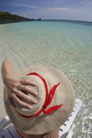 Woman sunbathing on a tropical beach Stock Photo - 3804643