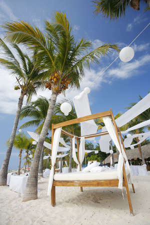destination wedding: Tables and Bed set up for a beach wedding on a tropical paradise beach