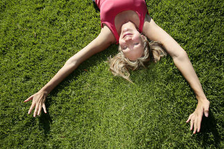 field study: Woman lying on grass in the sunshine