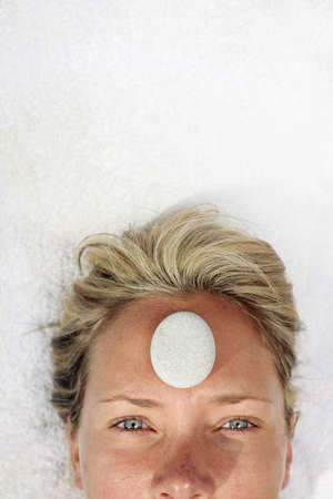 Woman at a spa with white stone on her forehead Stock Photo - 5052613