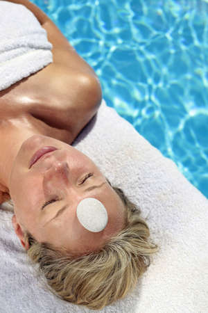 Woman at a spa with white stone on her forehead Stock Photo - 5052638
