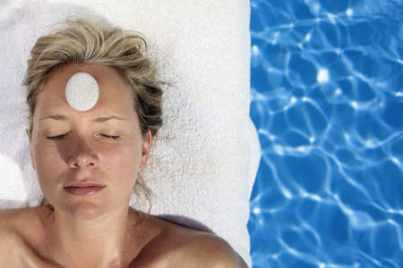 Woman at a spa with white stone on her forehead Stock Photo - 5052635