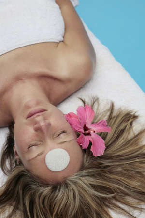 Woman at a spa with white stone on her forehead photo