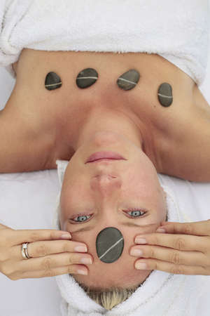 Woman at a spa with stone on her forehead Stock Photo - 5075409
