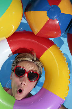 Woman having fun with an Inflatable Rubber Ring  photo