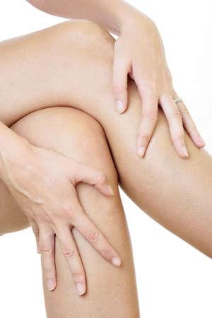 easing: Woman massaging her legs