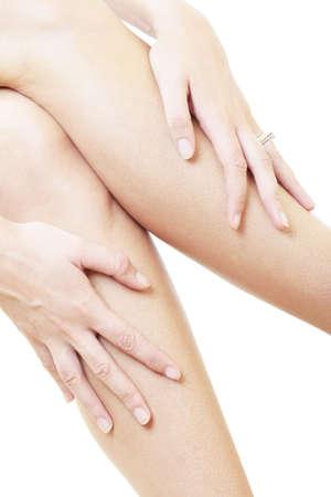 convulsion: Mujer masaje piernas
