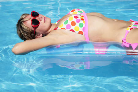 lilo: Portrait of a woman on a lilo in a pool Stock Photo