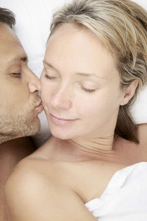 sex tenderness: An affectionate kiss in the morning