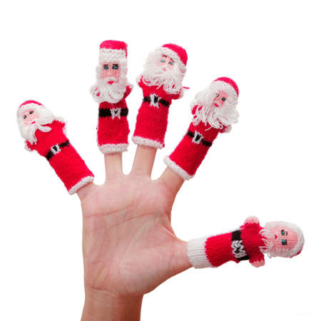 st  nick: Isolated hand with little Santa Puppets on  each finger