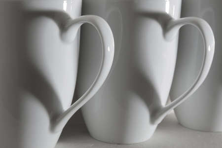 Three coffee cups with heart shaped shadows