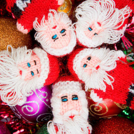 chrstmas: Tiny Santa Puppets on a Christmas stuff background