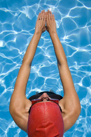 athletic gear: Athletic woman in swimming gear with blue swimming pool Stock Photo