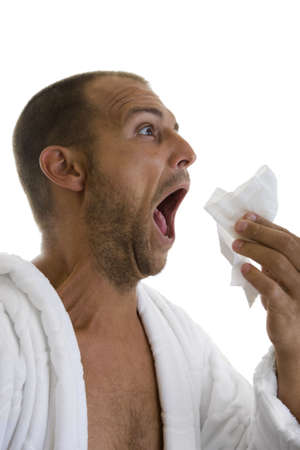 hankerchief: Man in a white bathrobe sneezing into a hankie