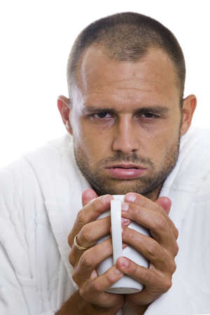 Man feeling ill with a mug of hot dreink Stock Photo - 5694347