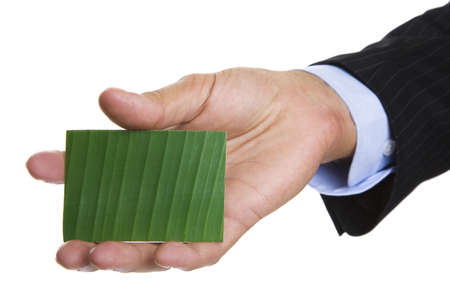 Man giving out a green business card photo