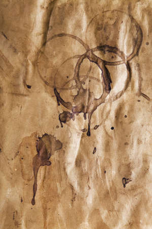grungey: Grungy background of old stained paper with coffee cup stains Stock Photo