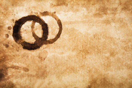 Grungy background of old stained paper with coffee cup stains Stock Photo