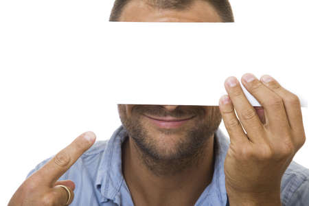 Businessman holding a blank sign in front of his face photo