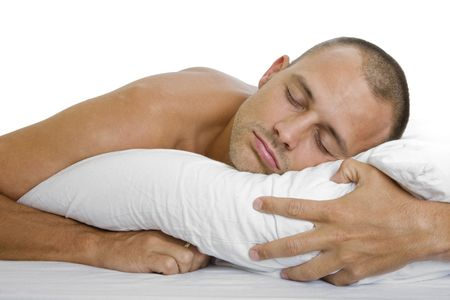 Man in bed sleeping peacefully with a pillow