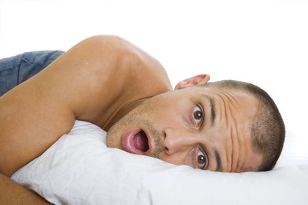 finds: Man waking up and being surprised by what he finds next to him Stock Photo