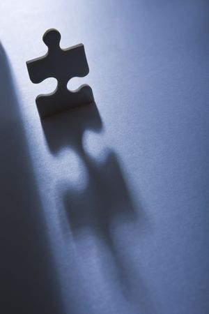 anthropomorphic: Backlit jigsaw piece standing up and looking anthropomorphic Stock Photo