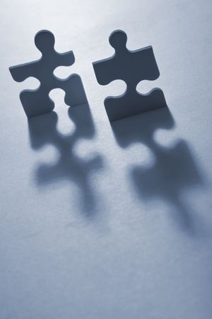 anthropomorphic: Backlit jigsaw pieces standing up and looking anthropomorphic  Stock Photo
