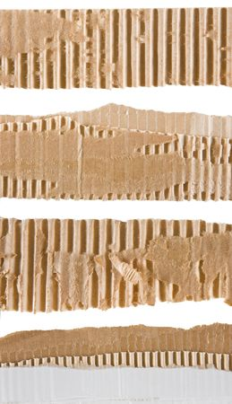 Torn strips of corrugated cardboard over white