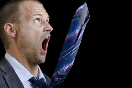 going crazy: Businessman with his tie going crazy Stock Photo