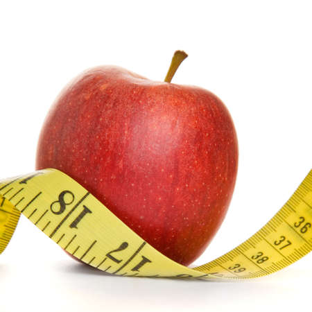centimetres: Red apple and tape measure in a square composition with white background