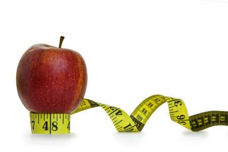 Red apple and tape measure with white background Stock Photo - 6462926