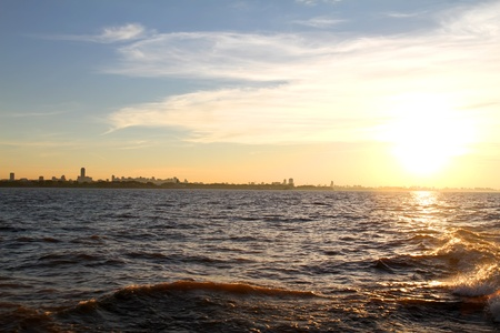 buenos: A sunset over the Rio de la Plata with the City of Buenos Aires in the background. Stock Photo